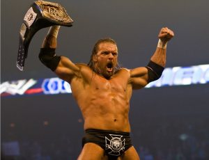 Triple H holding his belt after fighting