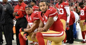 Two NFL players kneeling