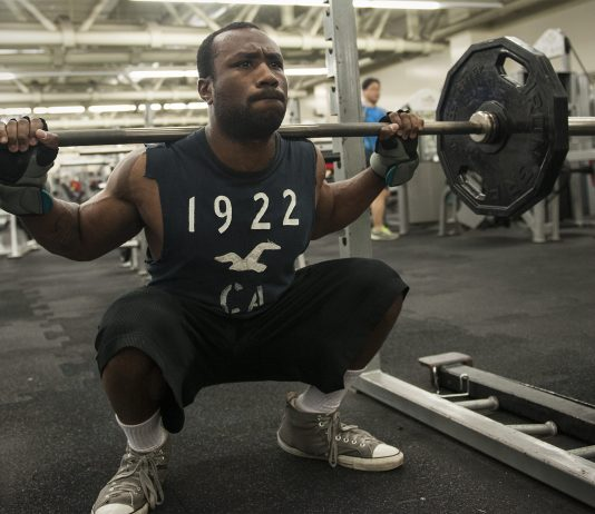 A man doing squat strength training
