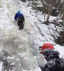 Ice Climbing with a blue rope