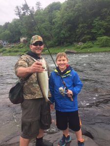 Bob Chase and his son fishing in Pennsylvania