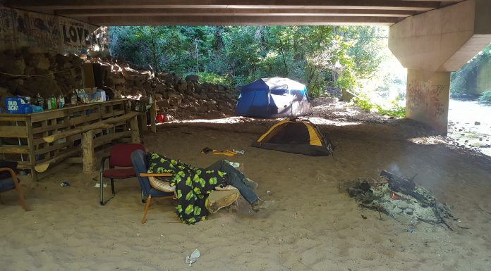 Two dudes are passed out under the bridge.