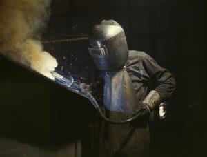 A welder is welding.