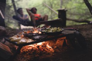Food cooking over a campfire on a camping trip.