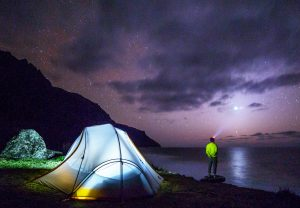 Camping trip at night next to the lake.