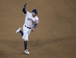 Carlos Correa rounding the bases and holding up his pointer finger