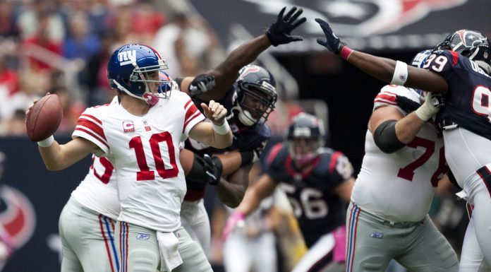 Eli Manning throws a pass against the Texans.