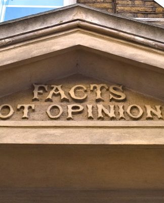 Facts not opinions chiseled on the face of a building