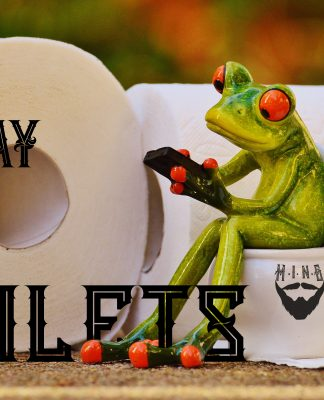 A ceramic frog is checking its phone while on the toilet.