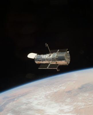 This image shows the Hubble Space Telescope orbiting Earth.