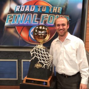 Christian Heimall posing with a 2014 athletics trophy