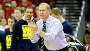 John Beilein clapping his hands together