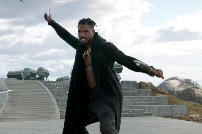 Eric Killmonger is wielding two swords preparing himself for battle.