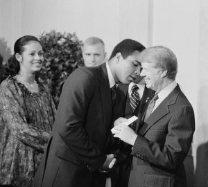 Muhammad Ali shaking hands with President Carter