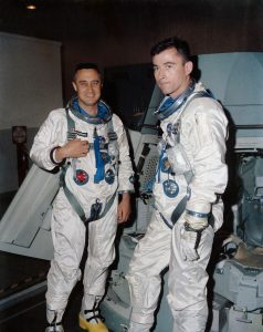John Young standing with another astronaut in their space suits