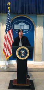 Robb Lee standing behind a mock Presidents podium