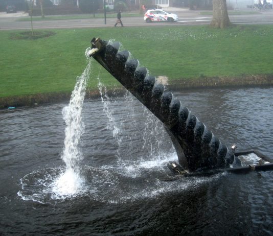 A photo of an Archimedes Screw bringing water upward.