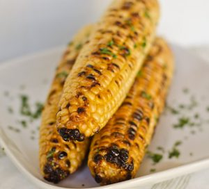 Ears of Grilled Corn with the side dishes