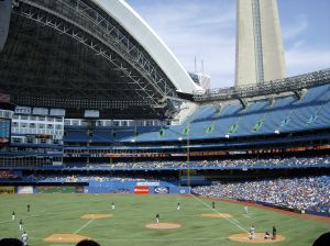 This picture shows the Rogers Centre in Toronto from the left field seating prospective. The roof is open and the Tigers are the opponents..