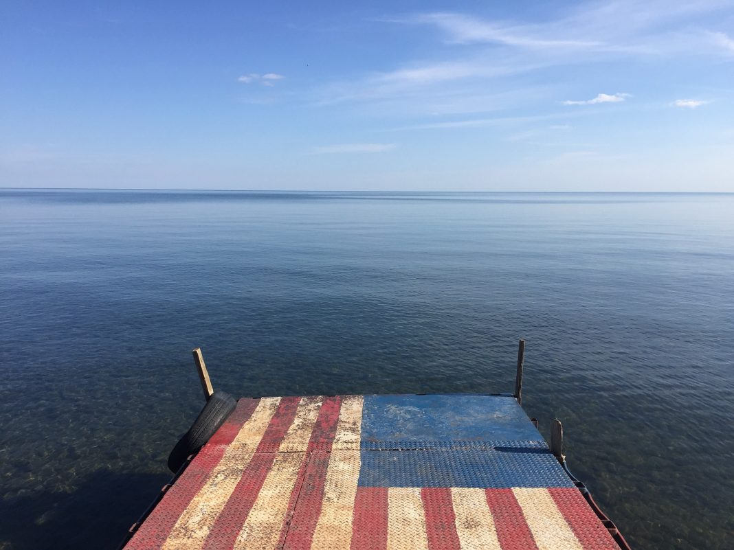 American flag painted on a lake dock