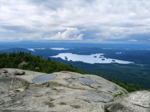 Mountain top view of lakes and a forest in New York