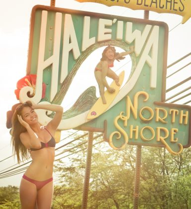 Annika Bauer posing next to Hale'iwa North Shore signs