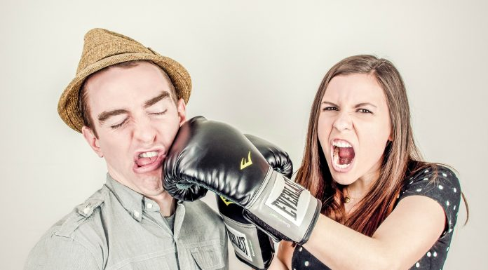 woman pretend to hit man during argument