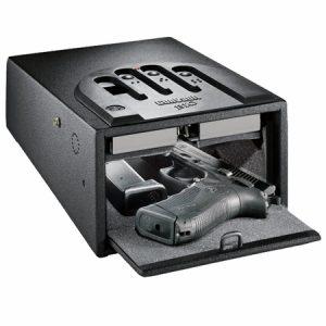 a handgun sitting in an open gun safe