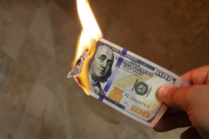 A 100 dollar bill burning