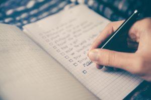 Someone creating a pre-sleep checklist