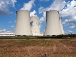 four cooling towers in a rural setting