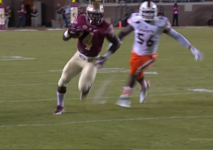 Dalvin Cook is running away from a defender on his way to a touchdown.