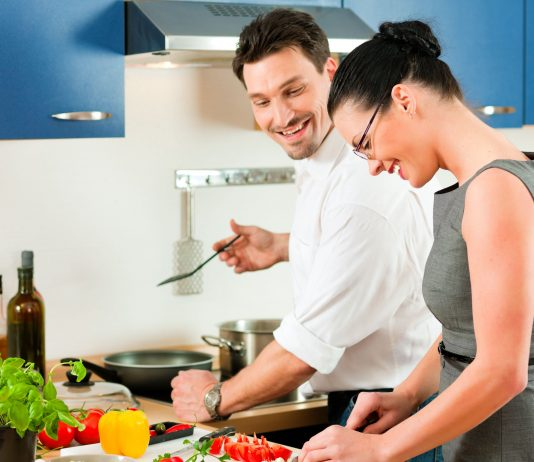 A Couple Cooking in the Kitchen