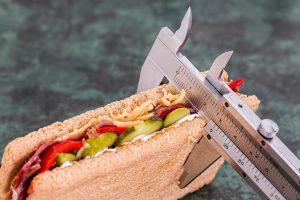 A width gauge checking width of food.