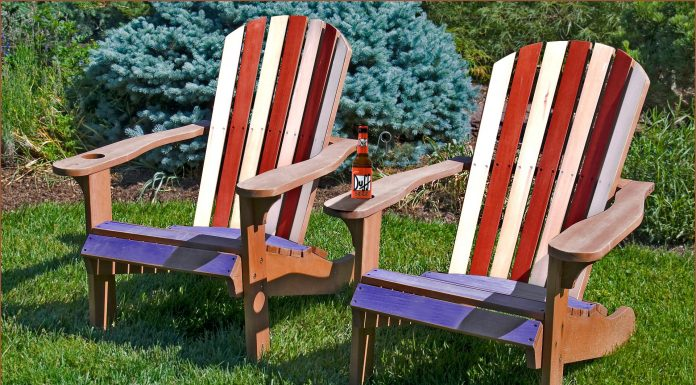 Adirondack chairs painted with the American flag with a Duff beer can on one armrest