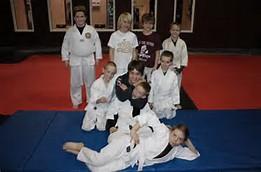kids taking a oicture at Brazilian Jiu-Jitsu practice