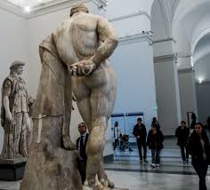 male statue of a man showing glutes