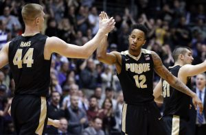 Purdue players giving a high five