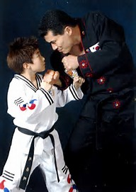 man and boy posing in martial arts uniform