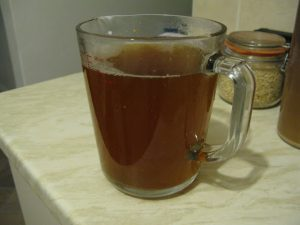Wort in a measuring cup during basic brewing process