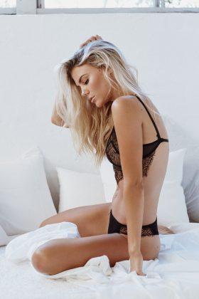 Brooke Nash on a bed