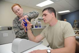 An Air Force occupational therapist treating overuse injuries
