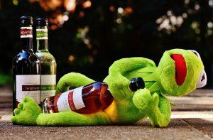 Kermit with wine bottles