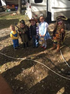 kids dressed up for halloween while camping