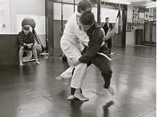 two kids live rolling in Brazilian Jiu-Jitsu