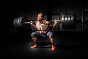 A man squatting a large amount of weight