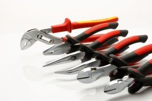 Picture of several sets of red-handled pliers for automotive use