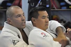 Royce Gracie giving instruction in the Gi performing a Brazilian Jiu-Jitsu technique