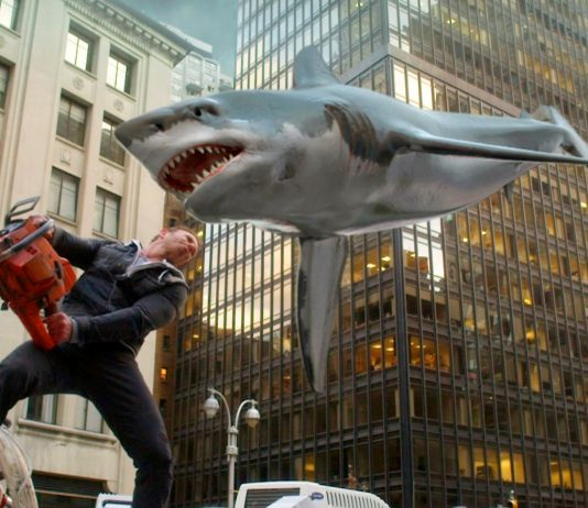 Sharknado - Ian Ziering prepares to carve a shark with a chainsaw, which is totally believable