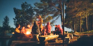 people at a campfire